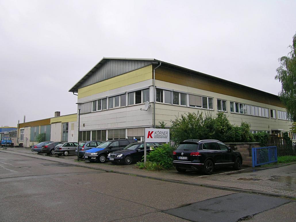 Wohn- und Geschäftshaus mit Werkstatt-/Lagerhallen und Pkw-Garagen ca. 13.500 m³ Brutto-Rauminhalt